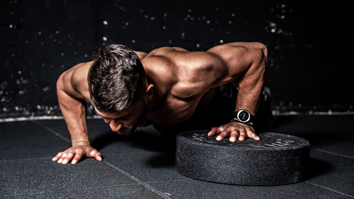Young strong sweaty focused fit muscular man with big muscles pe